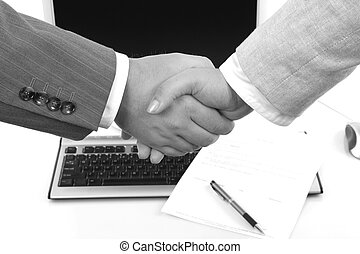 man and woman shaking hands in front of contract, in black & white tone