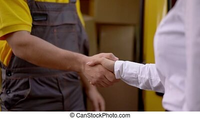 Man and Woman shaking hands. Outdoor. - Close-up Look On...