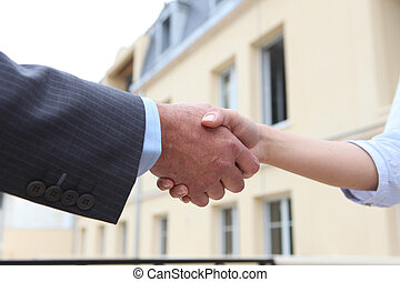 Man and woman shaking-hands
