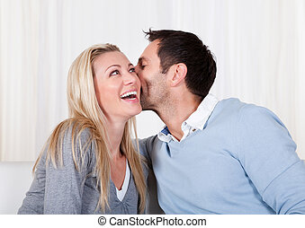 Man and woman sharing a secret