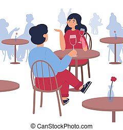 Man and woman sitting it the restaurant.