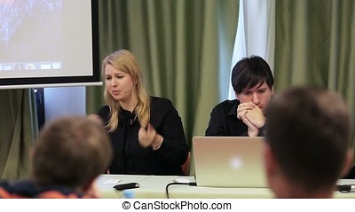 Man and woman speaking on lecture