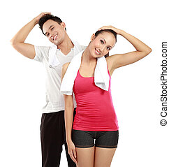 man and woman stretching - healthy fitness man and woman...
