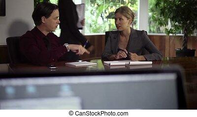 Man and woman talking at meeting