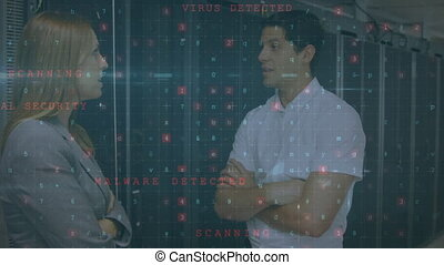 Man and woman talking in a computer server room