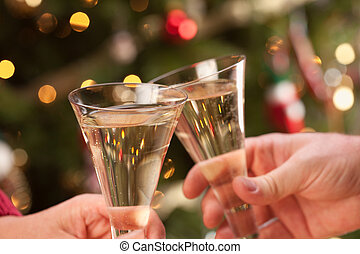 Man and Woman Toasting Champagne in Front of Lights - Man...