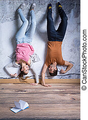 Man and woman upside down