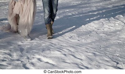 Man and woman walking in a park at winter day