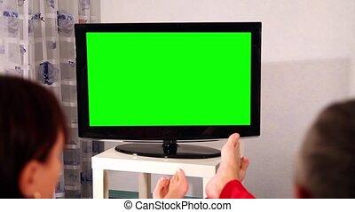 Man and woman watching television.