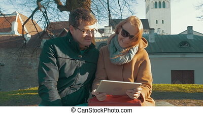 Man and woman watching video on tablet PC