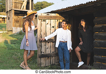 Man and Woman Welcomes Their Friend in the Wooden Wagon