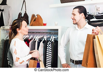 Man and woman with bags at store