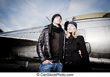 Man and woman with fighter plane