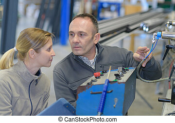 man and woman with machine cnc
