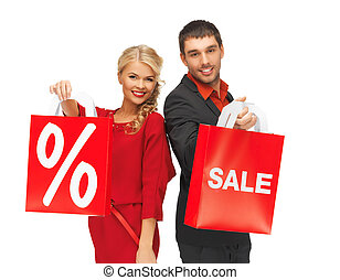 man and woman with shopping bag - bright picture of man and...