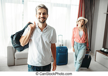 Man and woman with suitcases went on a journey