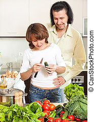 Man and woman with vegetables