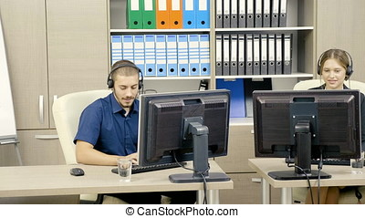 Man and woman working at customer support line