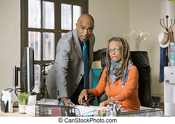 Man and Woman Working in a Creative Office