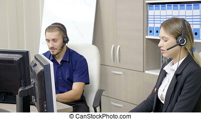 Man and woman working in customer support office