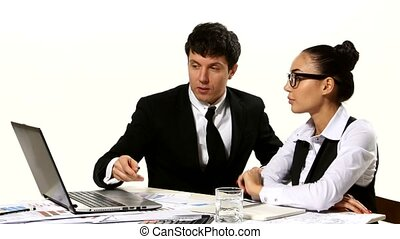Man and woman working together on a laptop in white background, developing a business project and analyzing market data information