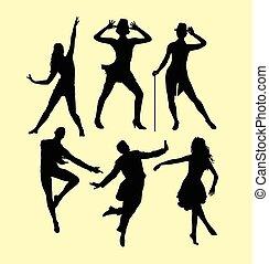 Man and women dancing silhouette - Man and woman dancing...