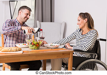 Man and women on wheelchair during meal