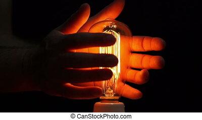 Man Antique Filament Bulb Hands - Close up shot of an...