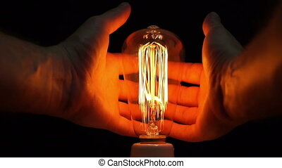 Man Antique Filament Bulb Hands - Close up point of view or...