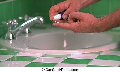 Man applying eye cream