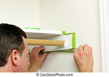 Man Applying Green Painter's Tape
