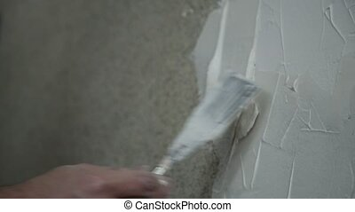 Man Applying Plaster on a Dry Wall. Construction worker...