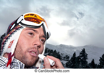 Man applying sunblock to lips