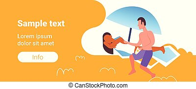 man applying suntan cream to his african american girlfriend sunbathing on beach sunbed sun protection cosmetic summer vacation concept full length horizontal copy space