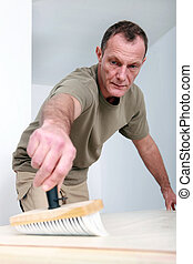 Man applying wallpaper paste