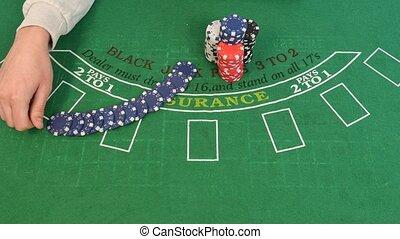 Man Apportions Poker Chips in 4k