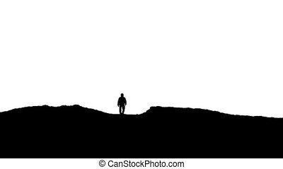 Man Approaches Over Hill Silhouette