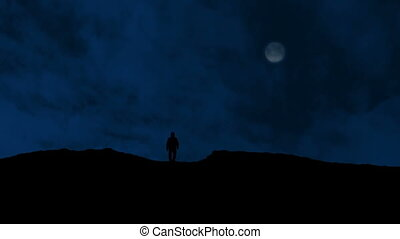 Man Approaches Over Hill With Moon Above