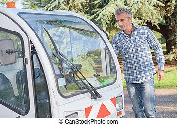Man approaching council maintenance vehicle