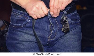 Man are buttoning a zipper