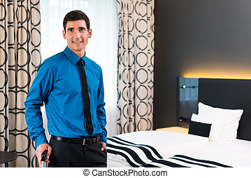 Man arrival in hotel room