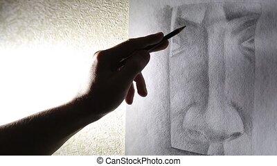 Man artist draws a nose with a graphite pencil HD 1920x1080p...