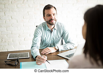Man asking woman to sign contract