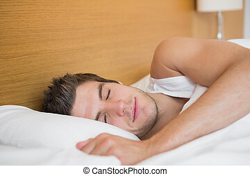 Man asleep in hotel room