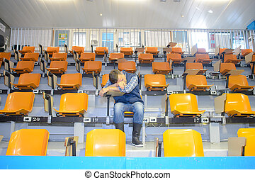 man asleep in stands