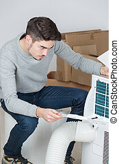 Man assembling air conditioning unit