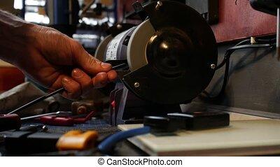 Man assembling bicycle - Man assebling bicycle in workshop....