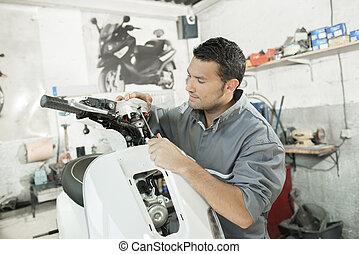 man assembling scooter