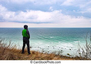 Man at coast. Boulders and white rocks at cape arkona - Man ...