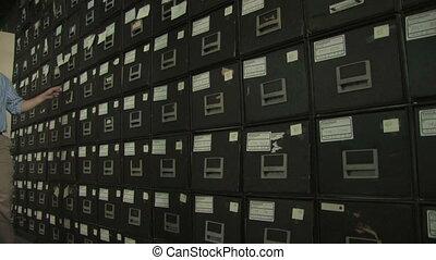 Man at File Cabinet 2